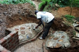 The Water Project: Wasenje Community, Margaret Jumba Spring -  Paving At Spring