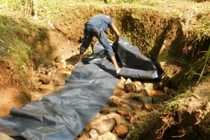 The Water Project: Shiru Community, Sammy Alumola Spring -  Lining Lower Part Of Spring