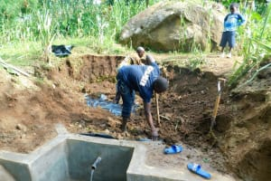 The Water Project: Shiru Community, Sammy Alumola Spring -  Spring Nearing Protection