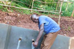 The Water Project: Emwanya Community, Josam Kutsuru Spring -  Ainea Bukachi Enjoying Clean Water