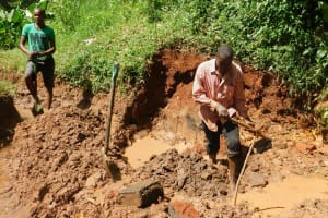 The Water Project: Jivovoli Community, Wamunala Spring -  Clearing Spring Area For Protection