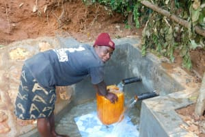 The Water Project: Jivovoli Community, Wamunala Spring -  Collecting Water At New Spring