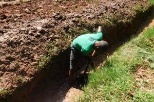 The Water Project: Jivovoli Community, Wamunala Spring -  Opening Of The Drainage Channel