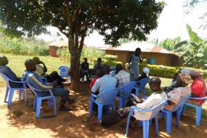 The Water Project: Jivovoli Community, Wamunala Spring -  People Listening During Training
