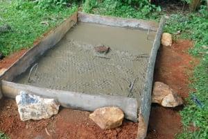 The Water Project: Jivovoli Community, Wamunala Spring -  Sanitation Platform Concrete Dries