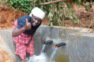The Water Project: Jivovoli Community, Wamunala Spring -  Thumbs Up