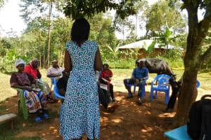 The Water Project: Jivovoli Community, Wamunala Spring -  Trainer Leads Discussion
