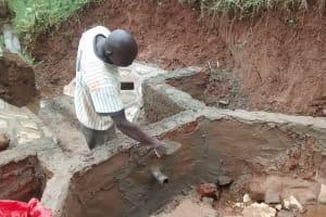 The Water Project: Jivovoli Community, Gideon Asonga Spring -  Constructing Spring Wall