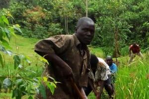 The Water Project: Jivovoli Community, Gideon Asonga Spring -  Gideon Asonga Leading Spring Users To Open Drainage Channel