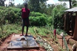 The Water Project: Jivovoli Community, Gideon Asonga Spring -  Standing On New Latrine Platform