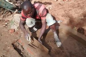 The Water Project: Jivovoli Community, Gideon Asonga Spring -  Cementing Bricks
