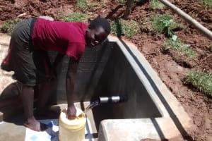 The Water Project: Jivovoli Community, Gideon Asonga Spring -  Collecting Water From New Spring