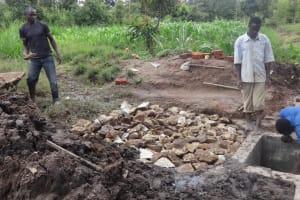 The Water Project: Ingavira Community, Laban Mwanzo Spring -  Laying Rock At Spring