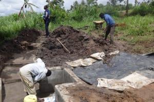 The Water Project: Ingavira Community, Laban Mwanzo Spring -  Spring Box Construction