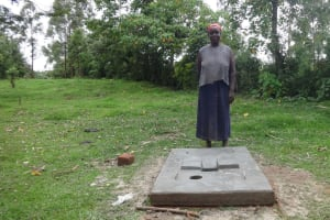 The Water Project: Ingavira Community, Laban Mwanzo Spring -  Standing At New Latrine