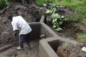 The Water Project: Masera Community, Ernest Mumbo Spring -  Digging Out Spring Bottom