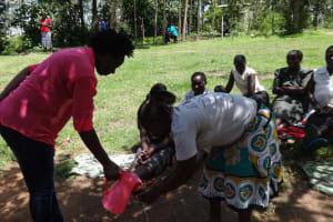 The Water Project: Masera Community, Ernest Mumbo Spring -  Handwashing Demonstration