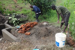 The Water Project: Masera Community, Ernest Mumbo Spring -  Mixing Cement