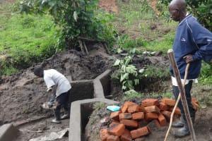 The Water Project: Masera Community, Ernest Mumbo Spring -  Preparing Bricks