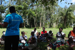 The Water Project: Masera Community, Ernest Mumbo Spring -  Trainer Speaking To Community Members