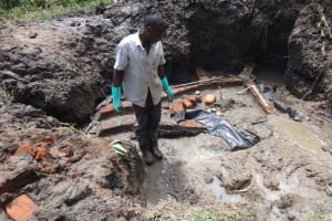 The Water Project: Masera Community, Salim Hassan Spring -  Bricking And Cementing The Spring