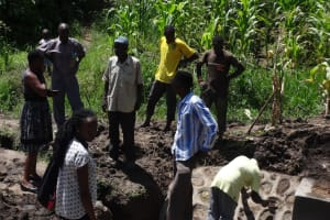 The Water Project: Masera Community, Salim Hassan Spring -  Community Members Inspect Completed Spring