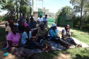 The Water Project: Masera Community, Salim Hassan Spring -  Community Members Listen During Training