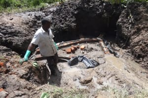 The Water Project: Masera Community, Salim Hassan Spring -  Preparing Spring For Protection