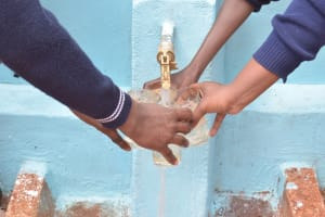 The Water Project: Mbuuni Secondary School -  Filling Up Water