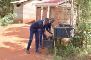 The Water Project: Mbuuni Secondary School -  Using New Handwashing Stations