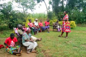 The Water Project: Mwituwa Community, Nanjira Spring -  Community Members Listen During Traing