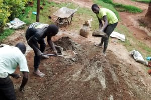 The Water Project: Mwanzo Primary School -  Mixing Cement