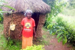 The Water Project: Mwituwa Community, Shikunyi Spring -  New Leaky Tin