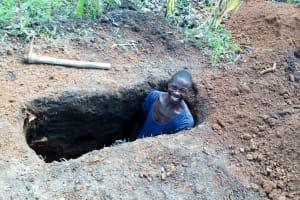 The Water Project: Ejinja Community, Anekha Spring -  A Community Member Preparing A Pit For His New Sanitation Platform