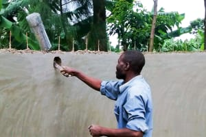 The Water Project: Mwanzo Primary School -  Fixing The Pipe