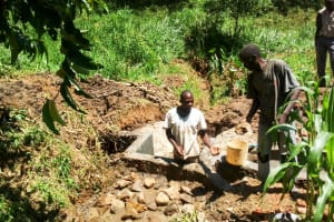 The Water Project: Mwituwa Community, Nanjira Spring -  Filling Behind The Spring Protection