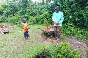 The Water Project: Mbande Community, Handa Spring -  Delivering Materials To The Spring