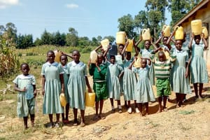 The Water Project: St. Joseph Eshirumba Primary School -  Students Delivering Water For Mixing Cement