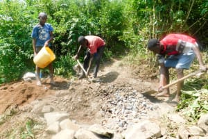 The Water Project: Ulagai Community, Aduda Spring -  Excavation And Foundation Construction Materials