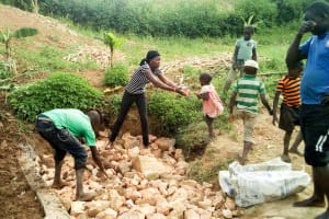 The Water Project: Musango Community, Jared Lukoko Spring -  Filling In The Spring Box
