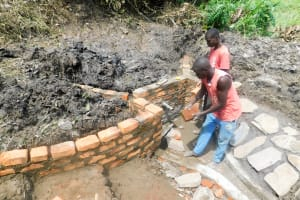 The Water Project: Ulagai Community, Aduda Spring -  Spring Protection Construction