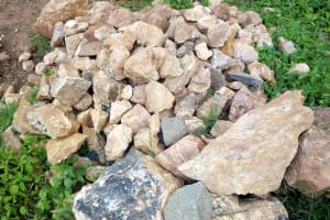 The Water Project: Muraka Community, Peter Itevete Spring -  Stones Gathered For Spring Protection
