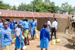 The Water Project: Eshiamboko Primary School -  Students Helping Get Water For Cement