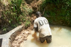 The Water Project: Matsakha Community, Mbakaya Spring -  Filling Up The Source Area With Stones