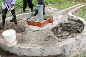 The Water Project: Vilongo Community -  Well Pad Construction