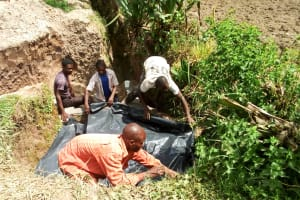 The Water Project: Matsakha Community, Mbakaya Spring -  Covering The Source Area With Plastic