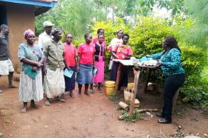 The Water Project: Mwituwa Community, Nanjira Spring -  Dish Drying Rack Demonstration