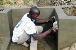The Water Project: Ulagai Community, Rose Obare Spring -  Spring Construction