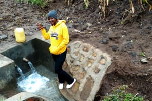 The Water Project: Burachu B Community, Shitende Spring -  Field Officer Jemmimah At Finished Spring