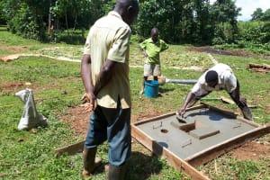 The Water Project: Mbande Community, Handa Spring -  Sanitation Platform Construction